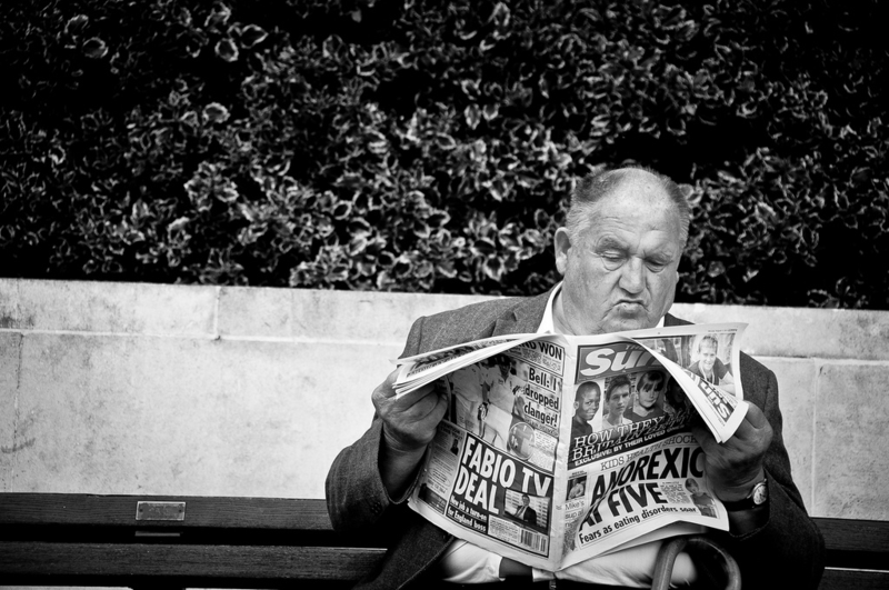 Man reads tabloids