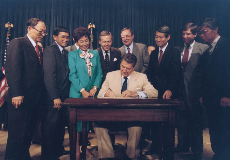 Reagan signing Japanese reparations bill