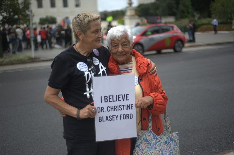 Kavanaugh_rally_at_Supreme_Court_-_two_women_with_sign