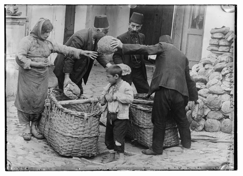 Armenian refugee woman and child receiving food aid