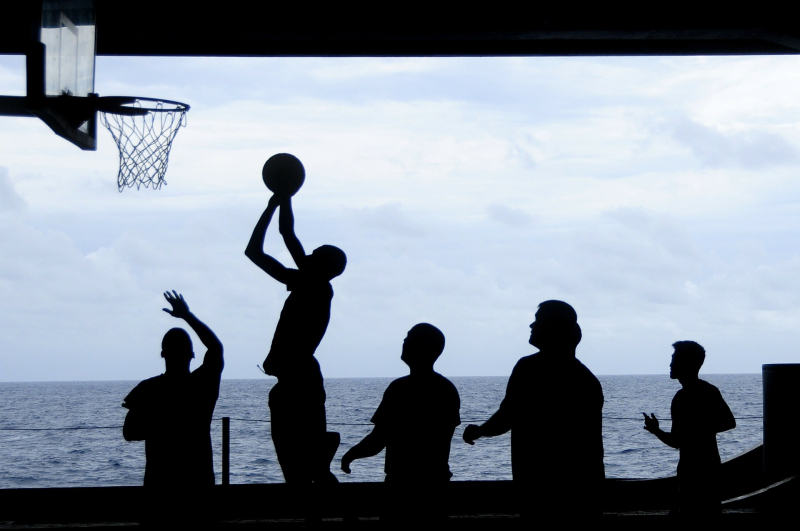 A group of people playing basketball