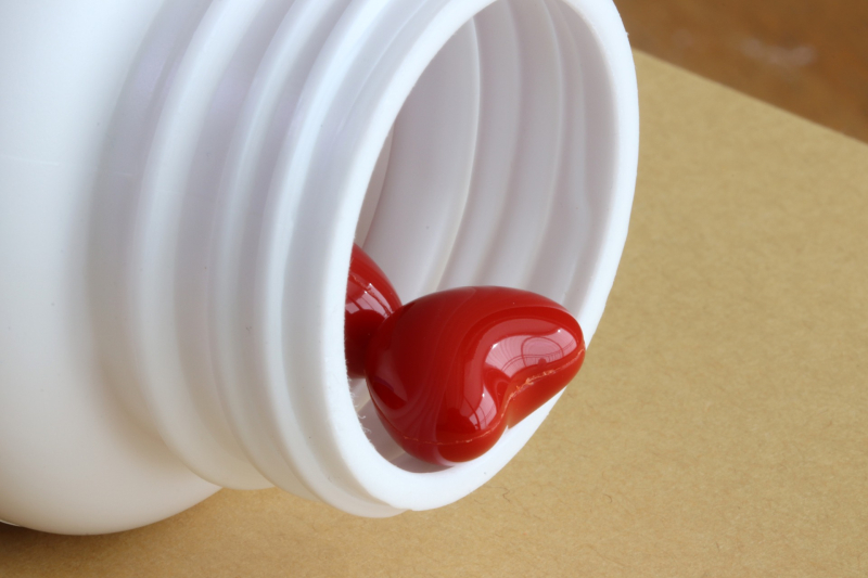 Red heart in a pill bottle